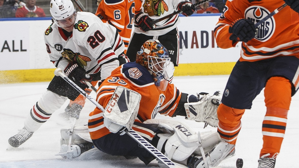 Chicago Blackhawks' Brandon Saad (20) is stopped by Edmonton Oilers' goalie Cam Talbot (33) during third period NHL action in Edmonton on Tuesday, Feb. 5, 2019. THE CANADIAN PRESS/Jason Franson