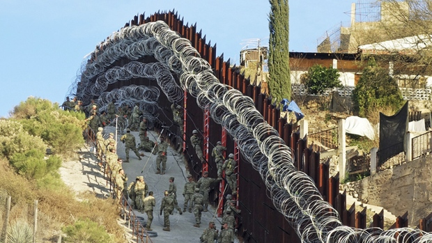 Officials say man shot at border is alive