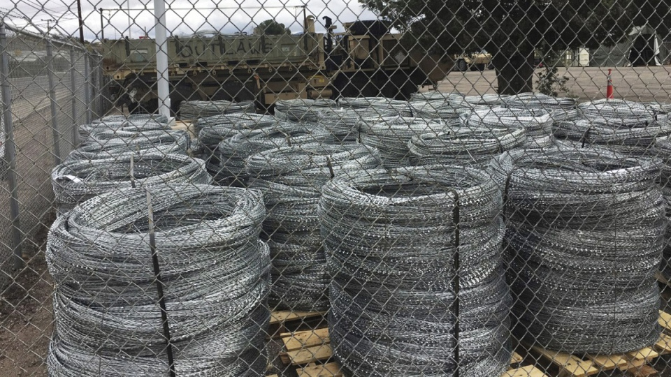 Bails of razor wire are awaiting installation on the U.S.-Mexico border fence on Tuesday, Feb. 5, 2019 in Nogales, Ariz. (Tim Steller / Arizona Daily Star via AP)