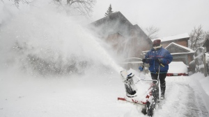 A woman uses a snowblower to dig out from the snow in Toronto on Tuesday, January 29, 2019. (THE CANADIAN PRESS / Nathan Denette)