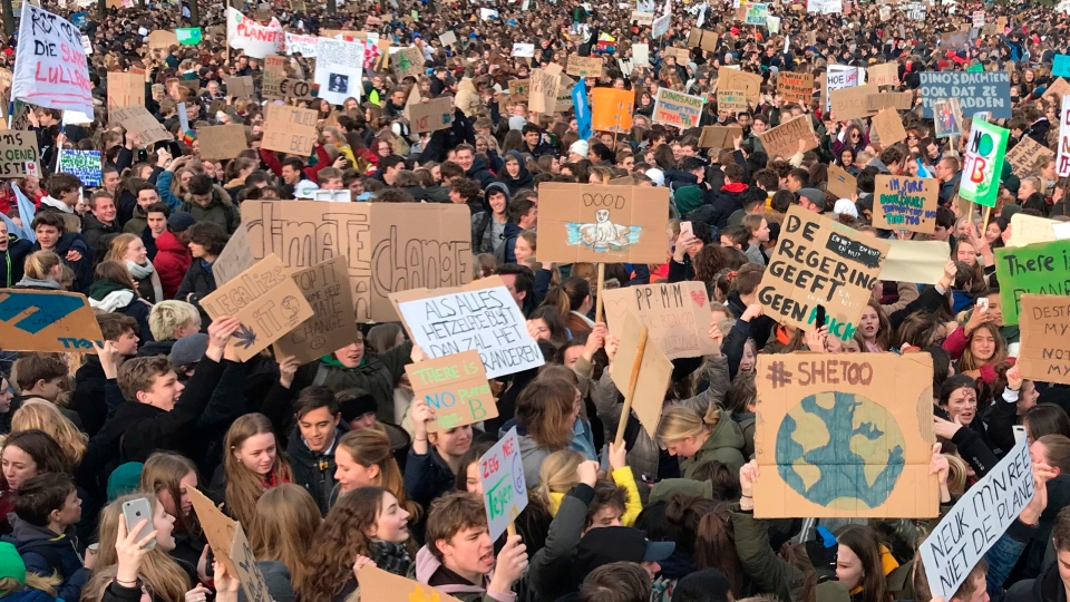 Some thousands of students gather to join a march in support of more ambitious climate policies in The Hague, Netherlands, Thursday Feb. 7, 2019. Organizers of the demonstration say they want to send a wake-up call to politicians in the Netherlands who are wrestling with how best to rein in greenhouse gas emissions. (AP Photo/Michael Corder)
