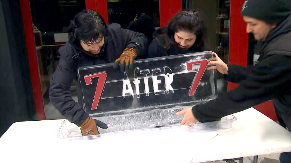 Business owners on King Street set up an ice sculpture detailing their new promotion, made in hopes of drawing customers to the street.