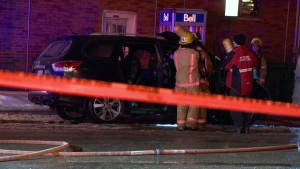 Montreal firefighters examine a car that was set ablaze at Jean Talon Blvd. and Chabot St. on Friday Feb. 8, 2019 (CTV Montreal/Cosmo Santamaria)