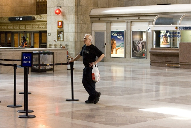 An unidentified man stands in the centre of a near empty concourse at Union Station in downtown Toronto on Friday, July 24, 2009. (Chris Young / THE CANADIAN PRESS)