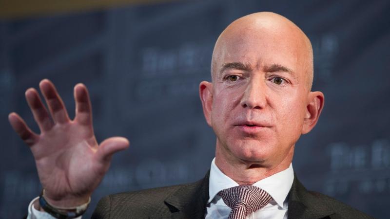 In this Sept. 13, 2018, file photo Jeff Bezos, Amazon founder and CEO, speaks at The Economic Club of Washington's Milestone Celebration in Washington. (AP Photo/Cliff Owen, File)