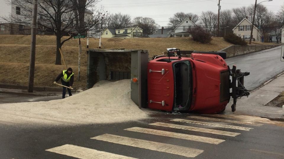 A Public Works salt truck is seen overturned on Main Street in Trenton, N.S., on Feb. 8, 2019. (New Glasgow Regional Police)
