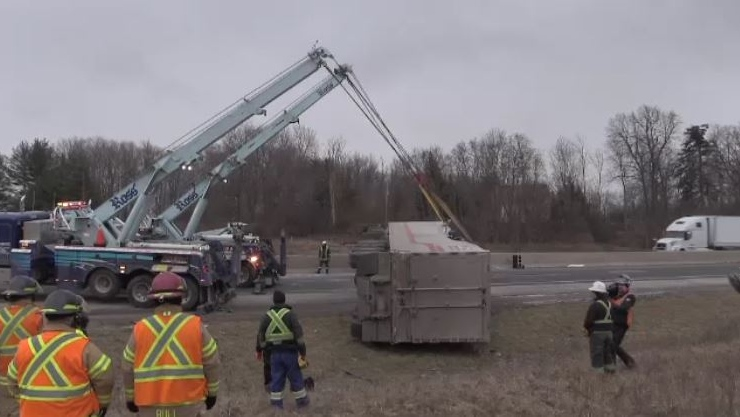 Crews work to remove a flipped transport truck on Highway 401 in London, Ont. on Friday, Feb. 8, 2019. (Gerry Dewan / CTV London)