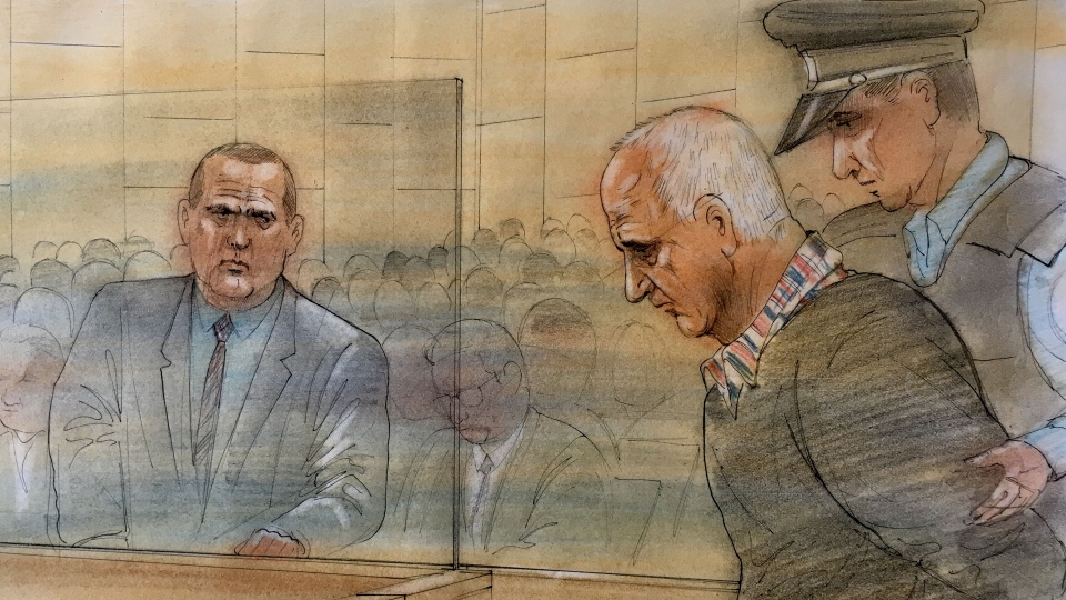 Toronto police detectives are pictured in court looking on as Bruce McArthur is led out. (John Mantha)