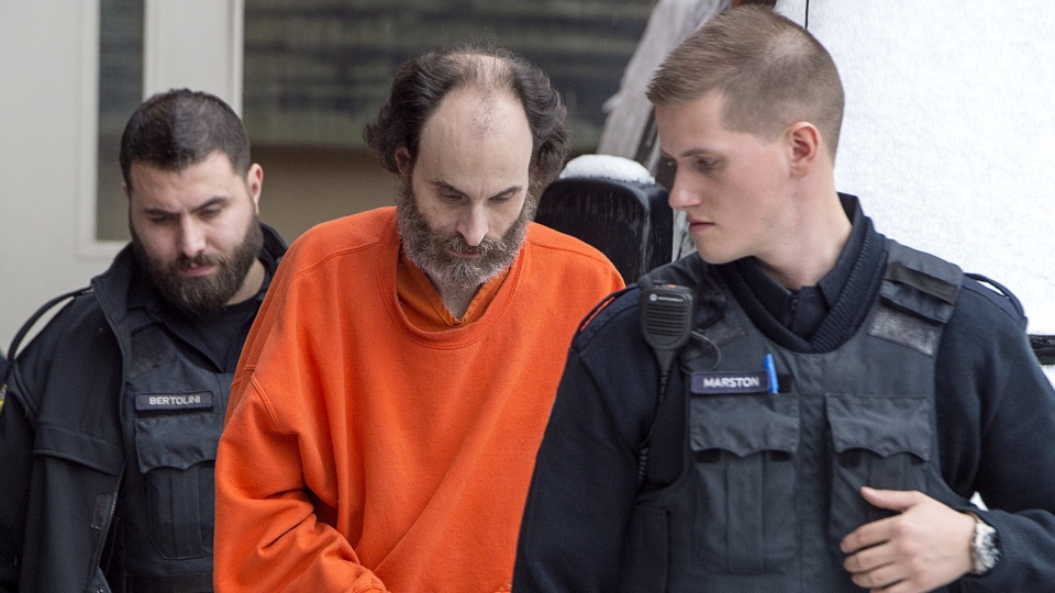 Matthew Vincent Raymond is escorted from provincial court in Fredericton on Friday, Feb. 8, 2019. (THE CANADIAN PRESS/Andrew Vaughan)