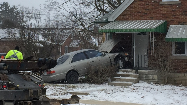 A vehicle after crashing into the front of a house