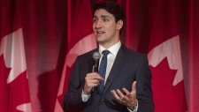 Prime Minister Justin Trudeau address attendees at the Liberal fundraising event at the Delta Hotel in Toronto, Ont., on Thursday, February 7, 2019. THE CANADIAN PRESS/ Tijana Martin