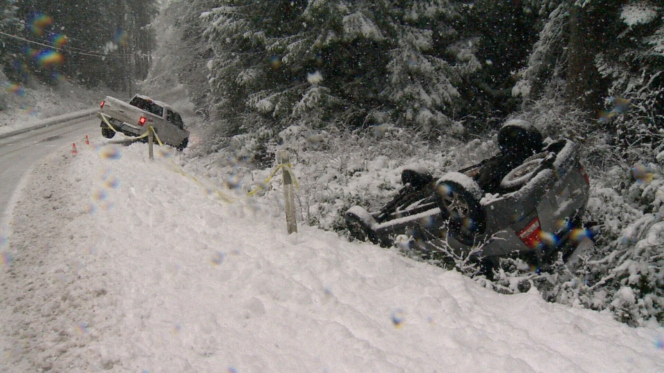 Multiple vehicles slid into ditches as snow rapidly accumulated on Gillespie Road in Sooke Friday, Feb. 8, 2019. (CTV Vancouver Island)