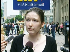 VIA spokesperson Ashley Doyle listens to a reporter's question during a strike update outside of Union station on Friday, July 24, 2009.