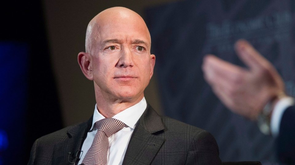 In this Sept. 13, 2018, file photo Jeff Bezos, Amazon founder and CEO, speaks at The Economic Club of Washington's Milestone Celebration in Washington. Amazon expects to begin recruiting next year for software developers, accountant, executives, managers, and human resources professionals for its new hubs in New York, Long Island City and the Washington suburb of Arlington. (AP / Cliff Owen, File)