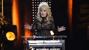 Dolly Parton accepts her award at MusiCares Person of the Year on Friday, Feb. 8, 2018, at the Los Angeles Convention Center. (Photo by Chris Pizzello/Invision/AP)