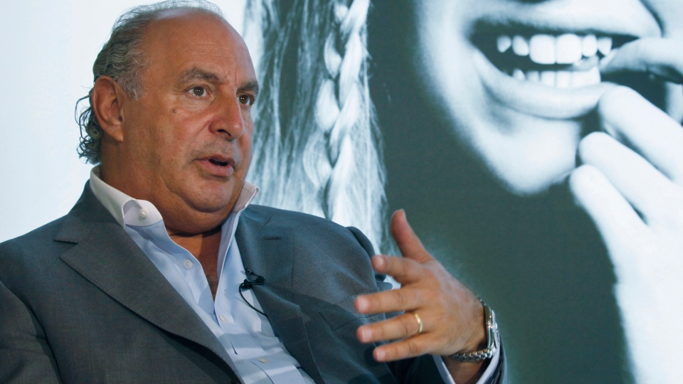 In this file photo dated Wednesday, June 5, 2013, Philip Green speaks during an interview at his new Topshop store in Hong Kong. (AP Photo/Kin Cheung, FILE)