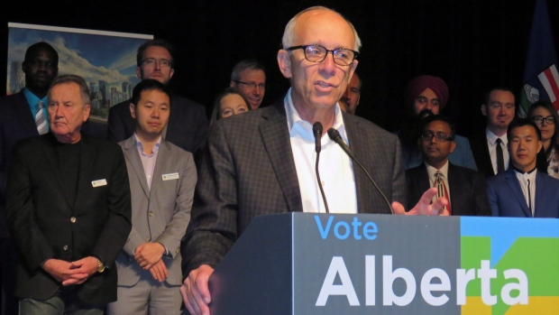 Alberta Party Leader Stephen Mandel, with nominated candidates standing behind him, speaks to members at the party's annual general meeting in Edmonton on Saturday, October 20, 2018. (THE CANADIAN PRESS/Dean Bennett)