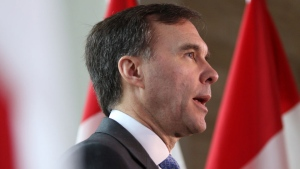 Federal Finance Minister Bill Morneau takes questions from the media during an announcement for Freedom Mobile at a press conference at the Delta Ocean Pointe in Victoria, B.C., on Friday, February 8, 2019. THE CANADIAN PRESS/Chad Hipolito