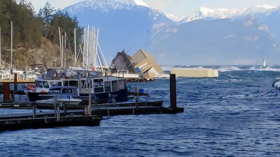 In Horseshoe Bay, heavy seas pushed nearly all of the rental boats at Sewell's Marina ashore and sank the facility's breakwater barge. (CTV)