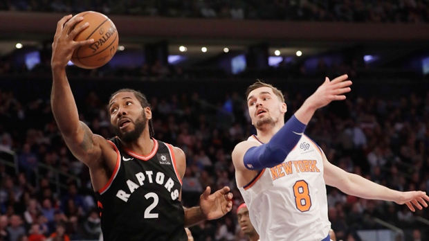 355220494 Toronto Raptors  Kawhi Leonard (2) catches a pass in front of New York  Knicks  Mario Hezonja (8) during the first half of an NBA basketball game