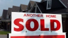 A for sale sign displays a sold home in a housing development in Ottawa on July 6, 2015. THE CANADIAN PRESS/Sean Kilpatrick