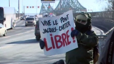 A demonstrator at the Jacques-Cartier Bridge
