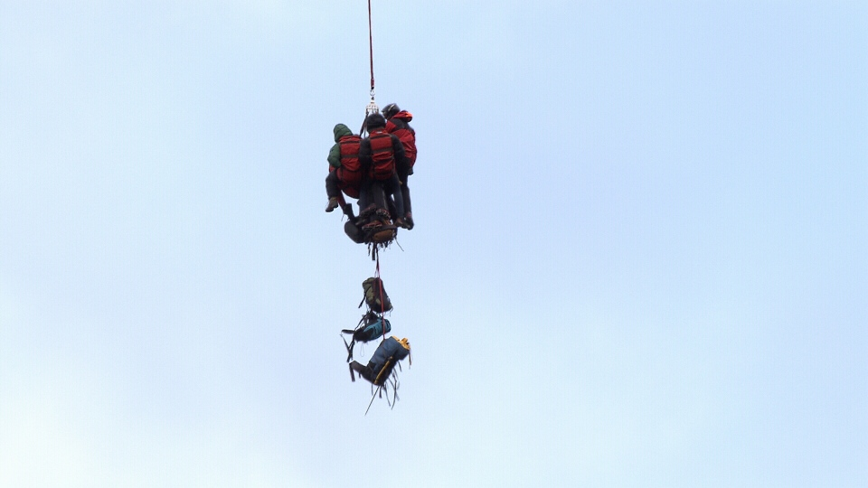 North Shore Rescue's long line team rescued two hikers who were stranded on Hat Mountain near Lions Bay.
