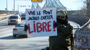 Protesting cyclists cross the Jacques-Cartier
