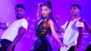 FILE - In this June 2, 2018 file photo, Ariana Grande, center, performs at Wango Tango in Los Angeles. (Photo by Chris Pizzello/Invision/AP, File)
