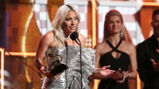 Lady Gaga accept the award for best pop duo or gro