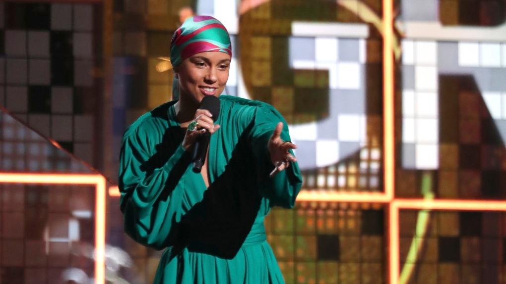 Host Alicia Keys speaks at the 61st annual Grammy