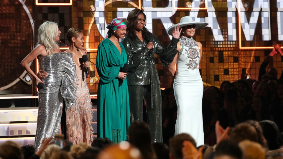 Lady Gaga, from left, Jada Pinkett Smith, Alicia Keys, Michelle Obama and Jennifer Lopez speak at the 61st annual Grammy Awards on Sunday, Feb. 10, 2019, in Los Angeles. (Photo by Matt Sayles/Invision/AP)