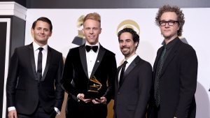 "Benj Pasek, from left, Justin Paul, Alex Lacamoire and Greg Wells pose in the press room with the award for best compilation soundtrack for visual media for ""The Greatest Showman"" at the 61st annual Grammy Awards at the Staples Center on Sunday, Feb. 10, 2019, in Los Angeles. (Photo by Chris Pizzello/Invision/AP)"