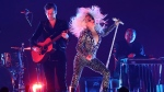 "Lady Gaga, right, and Mark Ronson perform ""Shallow"" at the 61st annual Grammy Awards on Sunday, Feb. 10, 2019, in Los Angeles. (Photo by Matt Sayles/Invision/AP)