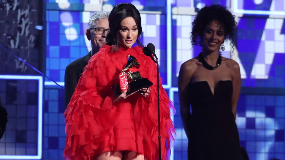 "Kacey Musgraves accepts the award for album of the year for ""Golden Hour"" at the 61st annual Grammy Awards on Sunday, Feb. 10, 2019, in Los Angeles. (Photo by Matt Sayles/Invision/AP)"