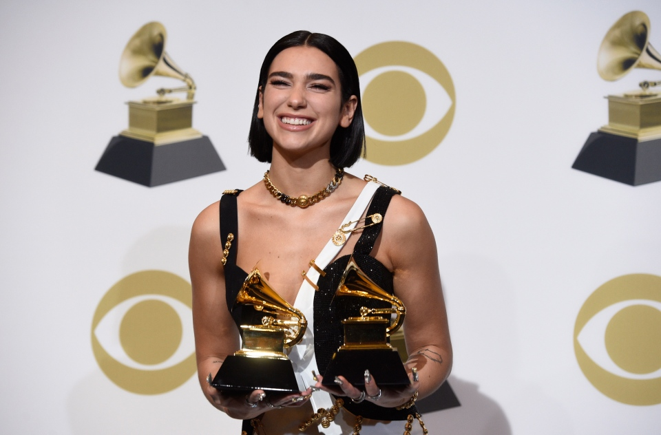 "Due Lipa, winner of the awards for best new artist and best dance recording for ""Electricity"" poses in the press room at the 61st annual Grammy Awards at the Staples Center on Sunday, Feb. 10, 2019, in Los Angeles. (Photo by Chris Pizzello/Invision/AP)"