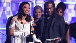 "Cardi B, left, accepts the award for best rap album for ""Invasion of Privacy"" as Offset looks on at the 61st annual Grammy Awards on Sunday, Feb. 10, 2019, in Los Angeles. (Photo by Matt Sayles/Invision/AP)"