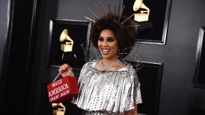"Joy Villa holds a purse that reads ""Make America Great Again"" at the 61st annual Grammy Awards at the Staples Center on Sunday, Feb. 10, 2019, in Los Angeles. (Photo by Jordan Strauss/Invision/AP)"
