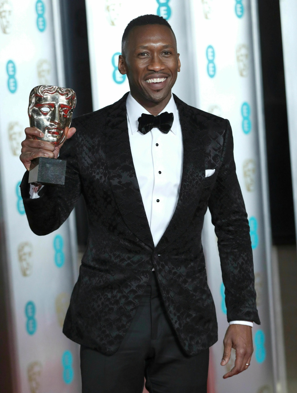 Mahershala Ali with his Best Actor in a Supporting Role Bafta for Green Book attending the after show party for the EE British Academy Film Awards at the Grosvenor House Hotel in central London, Sunday February 10, 2019. (Jonathan Brady/PA via AP)