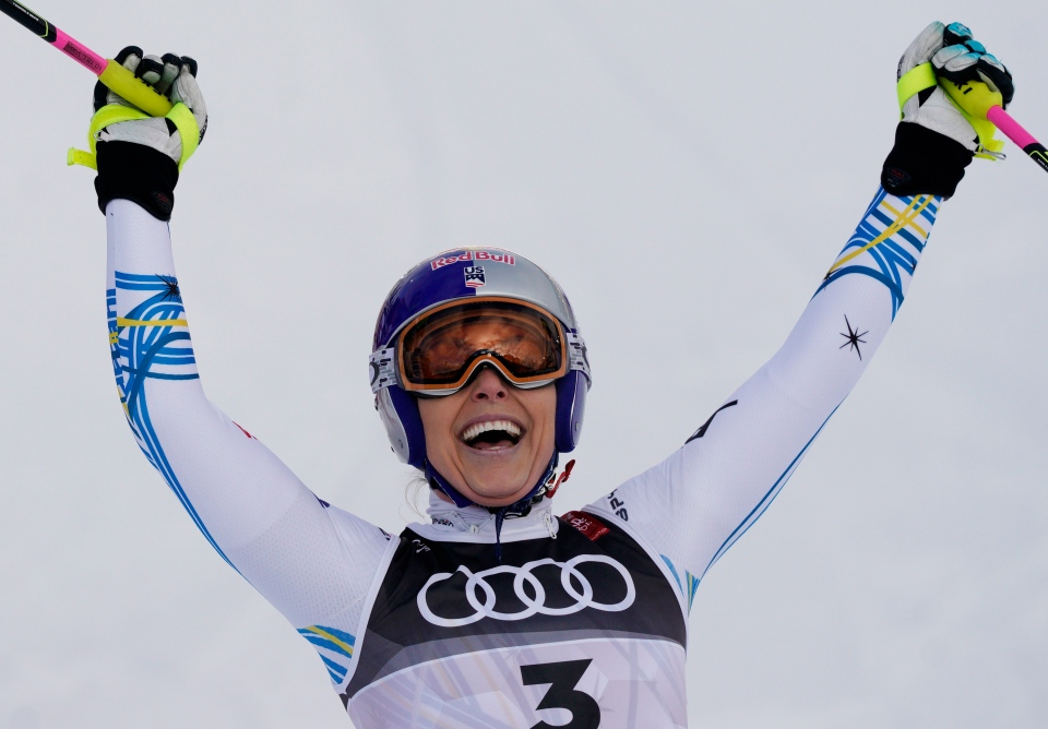 United States' Lindsey Vonn celebrates in the finish area after taking third place in the women's downhill race, at the alpine ski World Championships in Are, Sweden, Sunday, Feb. 10, 2019. (AP Photo/Giovanni Auletta)