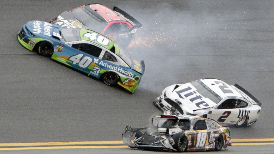 Jamie McMurray (40), Martin Truex Jr. (19), Brad Keselowski (2) and Kyle Busch (18) get caught up in a multi-car crash during the NASCAR Clash auto race at Daytona International Speedway, on Feb. 10, 2019, in Daytona Beach, Fla. (Darryl Graham / AP)