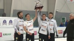 Team Kirk Muyres raises the SaskTel Tankard trophy in Whitewood.