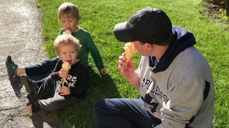 Mark Harrison eats ice cream with his sons. When an employee suggested that Harrison hold sensory-friendly shopping experiences at his grocery store, Harrison drew on his parenting experience to understand why it could be a good idea. (Mark Harrison)