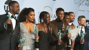 "Sterling K. Brown, from left, Angela Bassett, Lupita Nyong'o, Chadwick Boseman, Danai Gurira, Michael B. Jordan, and Andy Serkis pose with the award for outstanding performance by a cast in a motion picture for ""Black Panther"" in the press room at the 25th annual Screen Actors Guild Awards at the Shrine Auditorium & Expo Hall on Sunday, Jan. 27, 2019, in Los Angeles. (Photo by Jordan Strauss/Invision/AP)"