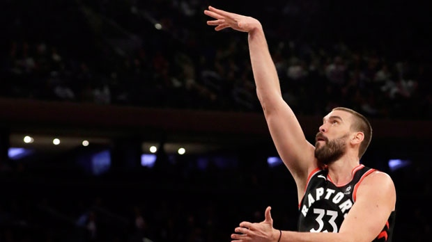 Toronto Raptors' Marc Gasol, right, shoots over New York Knicks' DeAndre Jordan during the first half of an NBA basketball game, Saturday, Feb. 9, 2019, in New York. (AP Photo/Frank Franklin II)