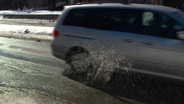 Vehicle hits pothole in Ottawa.