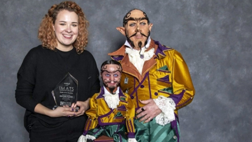 Victoria McNair, and her father as her model, places second in the misfits category at a makeup competition in Los Angeles