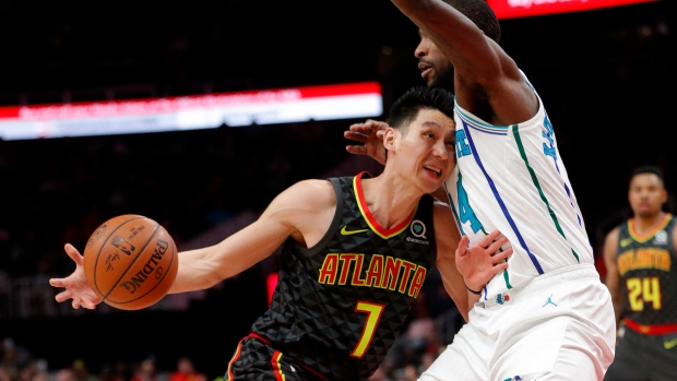 Atlanta Hawks guard Jeremy Lin (7) drives into Charlotte Hornets forward  Michael Kidd-Gilchrist (14) during the first half of an NBA basketball  Saturday 3eea8611f