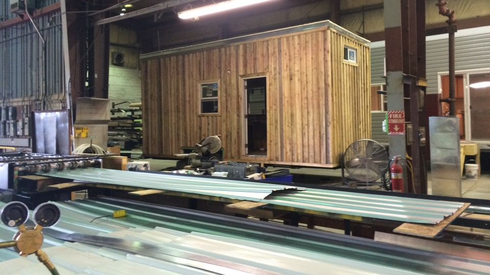 A tiny home being constructed on an RV frame is shown inside Green Terra Homes' warehouse. (Matt Standen)