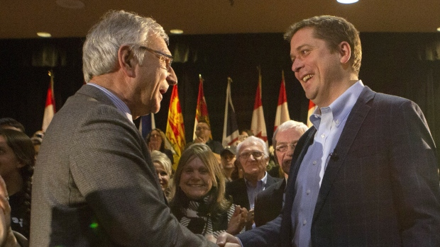 Federal Conservative Leader Andrew Scheer, right, is greeted by New Brunswick Premier Blaine Higgs before delivering remarks at a town hall event in Fredericton on Monday Feb. 11, 2019. THE CANADIAN PRESS/James West